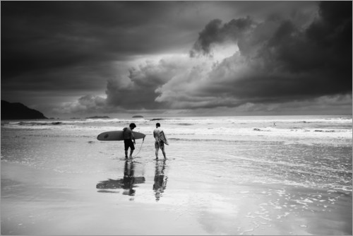 Premium poster Surfers on a stormy tropical beach