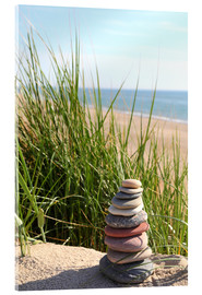 Acrylic print  A tower of stones on a dune at the sea - Buellom