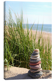 Canvas print  A tower of stones on a dune at the sea - Buellom