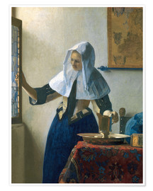 Premium poster Young woman with a water jug by the window