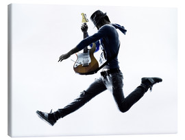 Canvas print  Guitarist jumping in the air