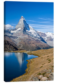 Canvas print  Hikers walking on the path beside the Stellisee with the Matterhorn reflected. Zermatt Canton of Val - Roberto Sysa Moiola