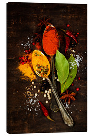 Canvas print  Bright spices on an old wooden board