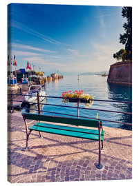 Canvas print  Bench on the coast of Garda in Peschiera