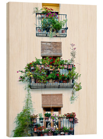Wood print  Facade with balconies full of flowers in Valencia