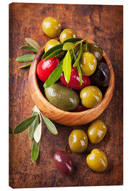 Canvas print  Bowl with olives on a wooden table - Elena Schweitzer