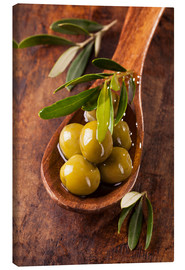 Canvas print  Spoon with green olives on a wooden table - Elena Schweitzer